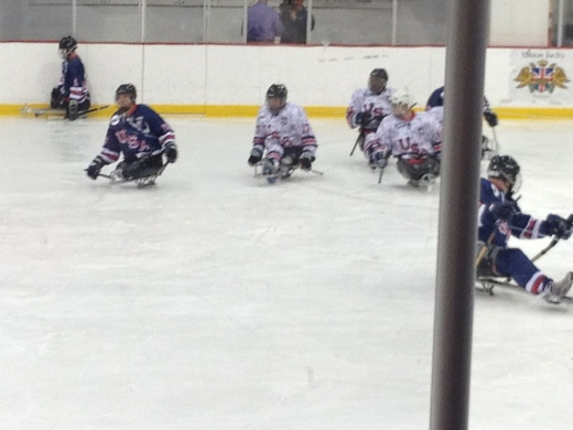 A hockey game being played by the Wounded Warriors.